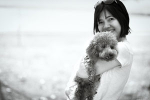 A poodle at the beach. Black and white dog photography.