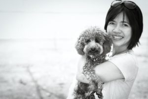 Black and white pet photography at the beach.